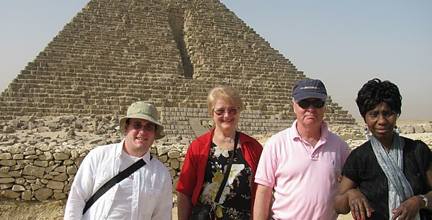 Paulist pilgrims Adam Warble of Pittsburgh;  Jane Wu of Calgary, Alberta; spiritual director Father Paul G. Robichaud, C.S.P., from Washington, D.C.; and Gladys George from New York City stand before the third pyramid in Giza.