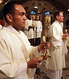 Rev. Mr. Rene I. Constanza, CSP (left) and Rev. Mr. Richard R. Andre, CSP, prepare to offer the Blood of Christ during the Mass in which they were ordained deacons in the Paulist community.