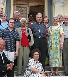 Archbishop Michael L. Fitzgerald, papal nuncio to Egypt (center), hosted the Paulist pilgrims at his home for Mass, refreshments and camaraderie.