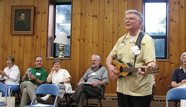 Father D. Bruce Nieli, C.S.P., plays his backpacker guitar during a session of the East Coast Holy Spirit retreat.