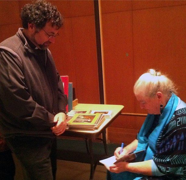 Father Frank Desiderio, CSP, director of the Paulist Center in Boston, gets a book autographed by Dr. Megan McKenna.