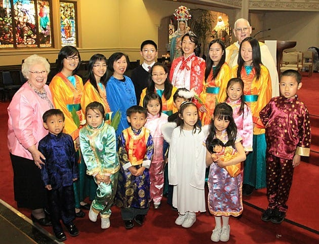 Mary's court – children at St. Mary's School – gathers with St. Mary's Principal Nancy Fiebelkorn (far left) and Father Daniel McCotter, CSP, pastor of Old St. Mary's Cathedral, Holy Family Chinese Mission and St. Mary's School and Chinese Center in San Francisco.