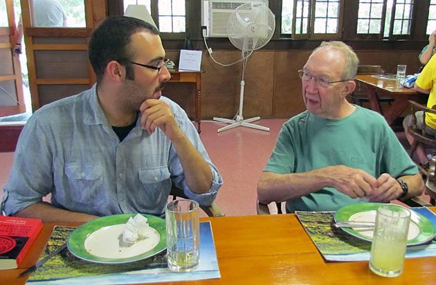 Matthew Berrios, Paulist seminarian, chats with Father Charlie Martin, CSP, in the refectory of St. Mary's on the Lake in Lake George, N.Y.