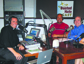 Father Steven Bell, CSP (center) with Father Dave Dwyer, CSP (left) and Mike Hayes (right) in the Busted Halo broadcast studio.