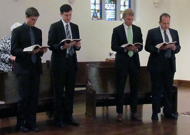 Evan Cummings (left) , Paulo Puccini, Michael Cruickshank and Daniel Arthur sing the entrance hymn during the Mass where they will officially sign in as Paulist novices Aug. 24 at St. Paul's College in Washington, D.C.