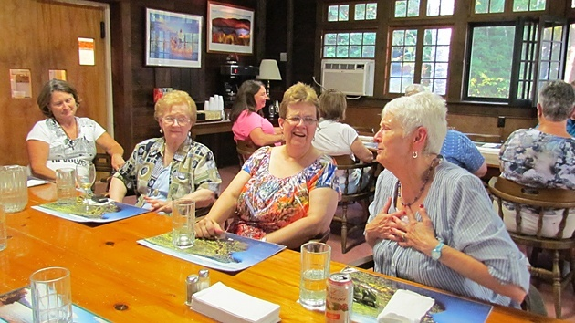 The Paulist Associates chat over dinner in the refectory of St. Mary's on the Lake, Lake George, N.Y., the site of this year's Associates' retreat.