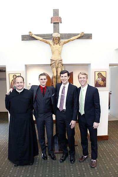 Daniel Arthur, Evan Cummings, Paolo Puccini, and Michael Cruickshank stand outside the St. Paul's College Chapel before the Mass where they made their first promise with the Paulist community.