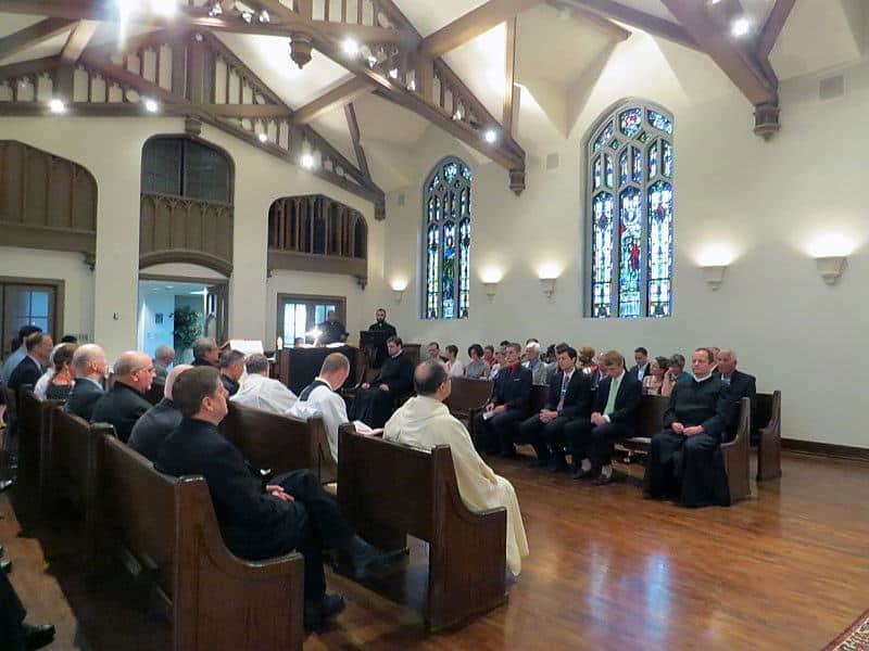 Family and friends gathered at St. Paul's College July 26 for the first promise of four men with the Paulist community.