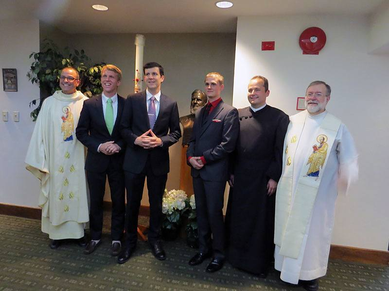 Paulist President Eric Andrews (left); Michael Cruickshank CSP; Paolo Puccini, CSP; Evan Cummings, CSP; Daniel Arthur, CSP; and Paulist Novicemaster Father Rich Colgan gather for a photo op after the Mass during which the four men made their first promise with the Paulist community.