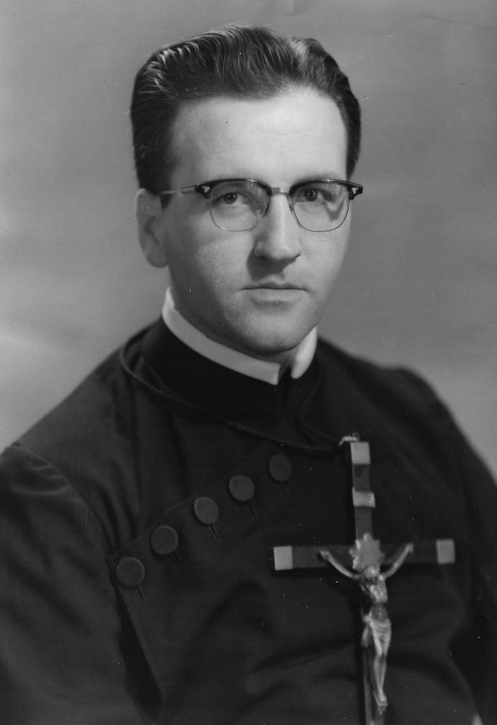 Paulist Fr. Joseph Mahon wearing the Paulist habit and mission cross in May, 1959.