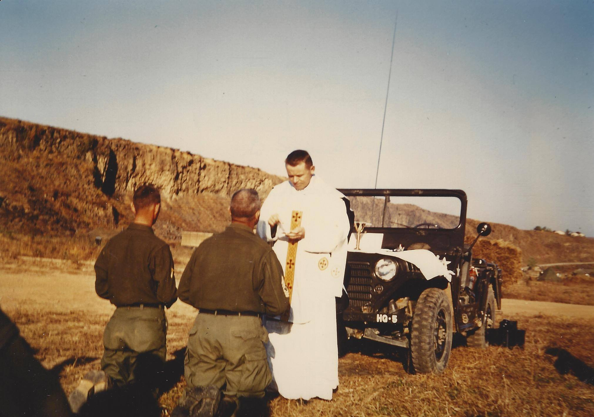 Paulist Fr. Kevin Devine speaking at the end of a Mass in Korea during his service as a U.S. Army chaplain.
