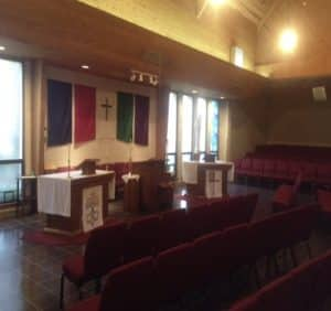 Sanctuary view of the two altars and ambo.