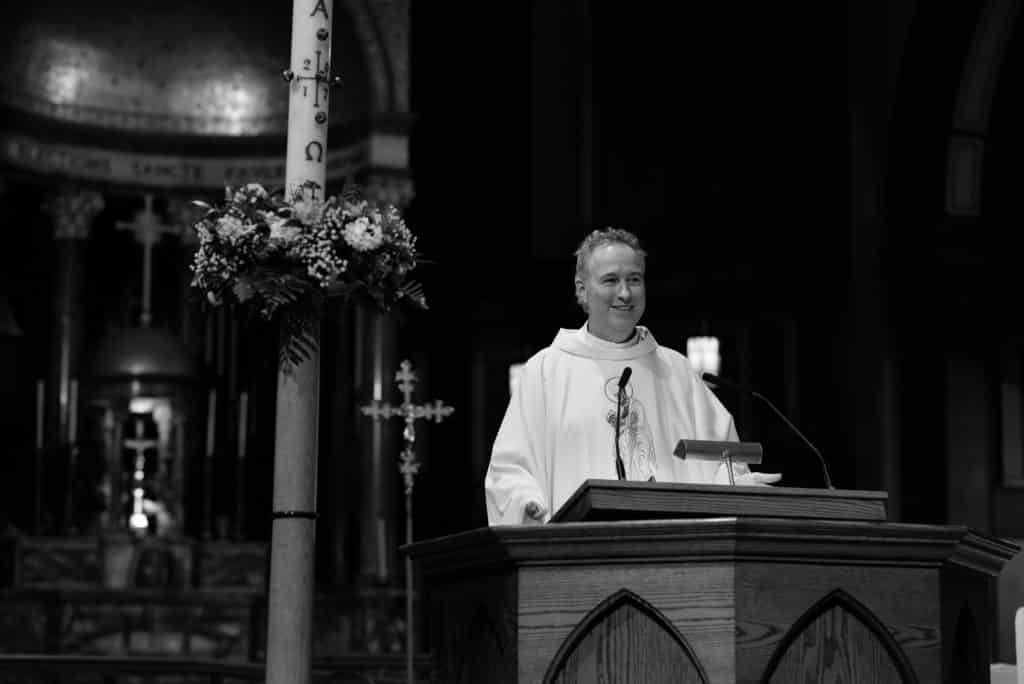 Paulist Fr. Rick Walsh preaching the homily