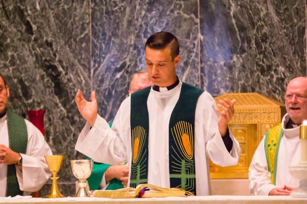 Fr. Sam Matthiesen praying part of Eucharistic Prayer as a concelebrant during Mass on August 26, 2017.