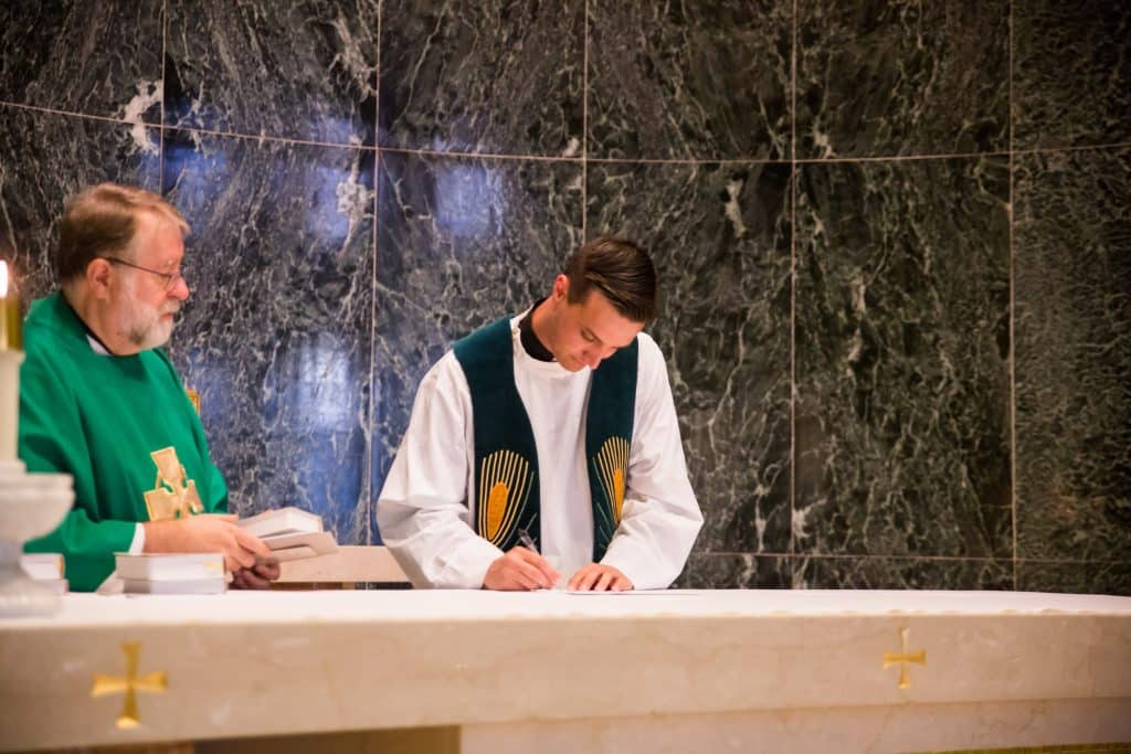 "Fr. Sam Matthiesen ""signs in"" as a Paulist novice on August 26, 2017."