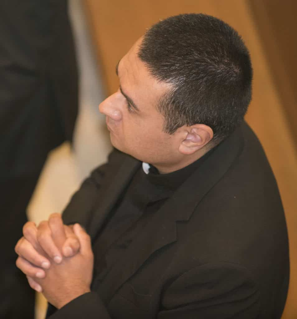Paulist seminarian Geno Flores prays during the special Mass on Friday, September 1, 2017, at which he made his first promises to the Paulist community.