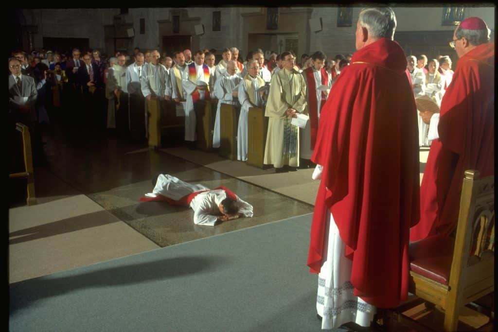 james-diluzio-lies-on-floor-at-ordination-at-good-shepherd-in-inwood