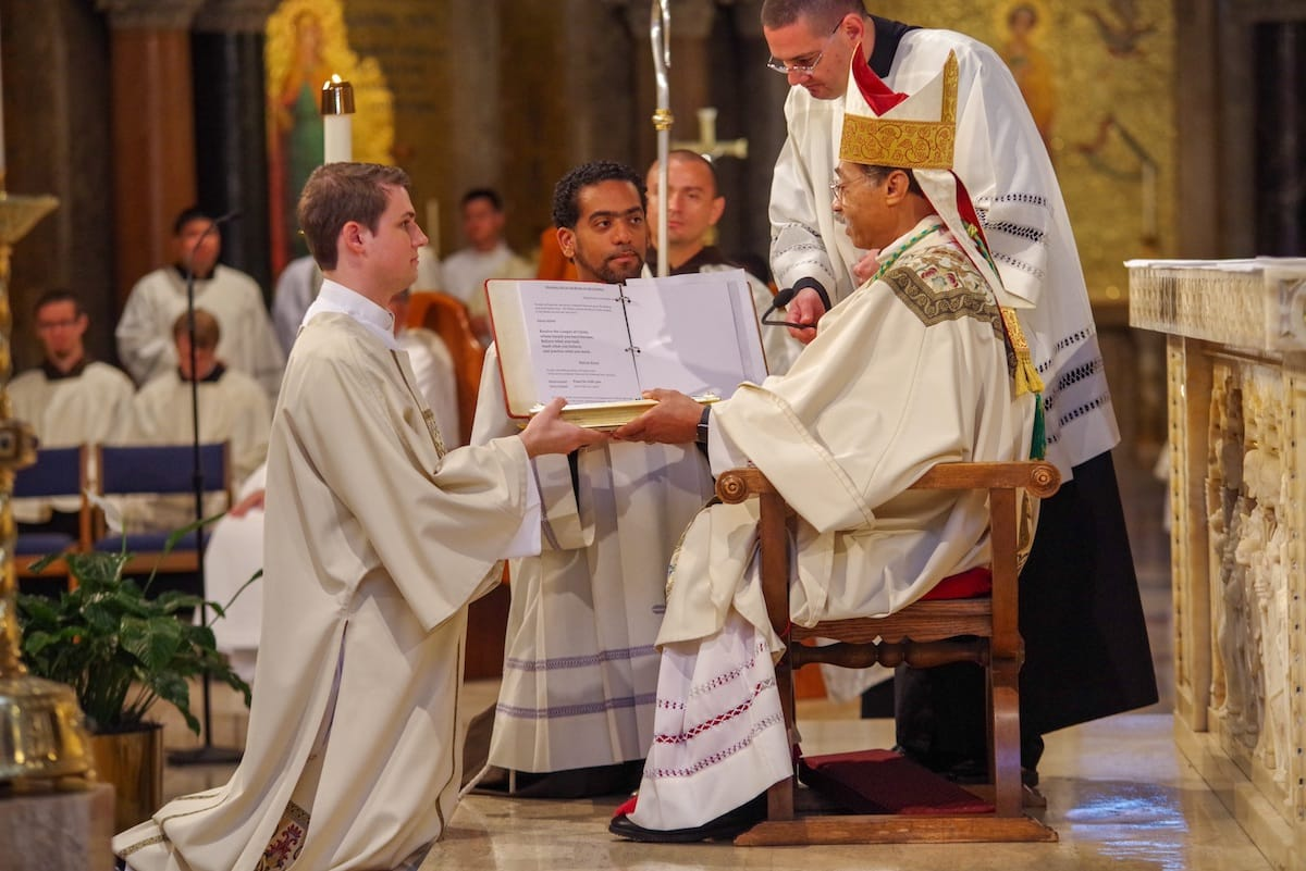 brand_new_deacon_paulist_evan_cummings_presented_book_of_the_gospels_at_diaconate_ordination_mass