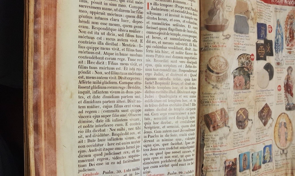 Figure 6: A close-up of the Missale Romanum, Page 94 after it was glued from the spine to the edge of the holiday catalog prior to aging