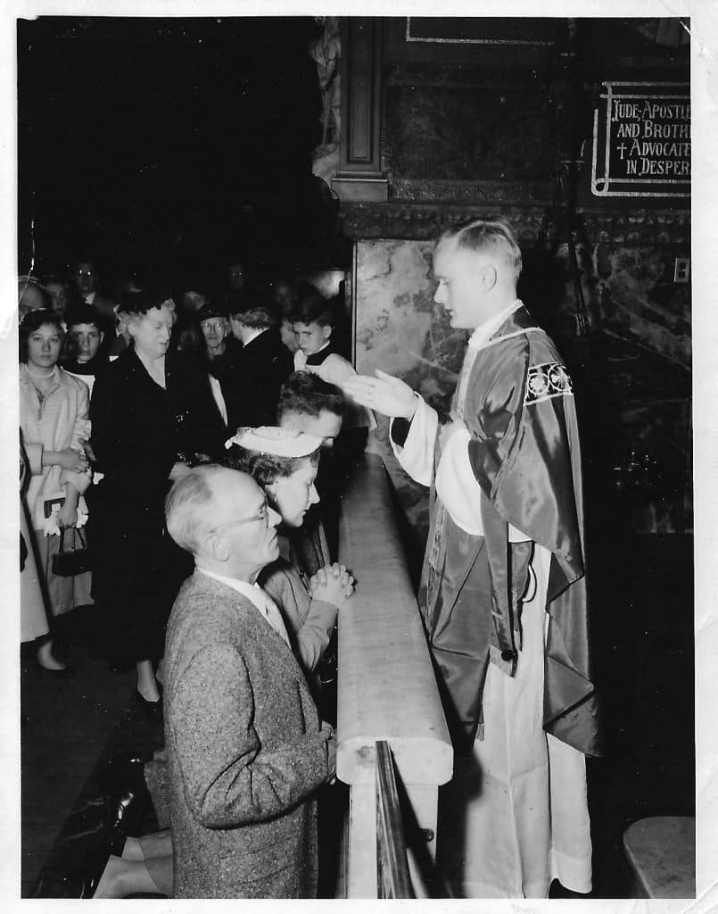 Paulist_Fr._James_McQuade_giving_his_first_priestly_blessing_to_his_parents_on_May_3_1956