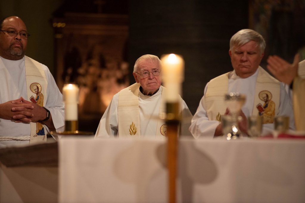 Fr. Kevin (center) at the Mass celebrating the start of the Hecker bicentennial year, December 18, 2018.